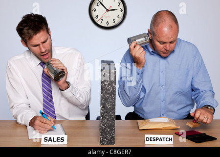 Amusing photo showing the behind the scenes reality of the sales and despatch departments for a small business - Stock Photo