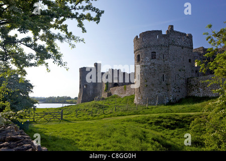Carrew ruined castle in spring sunshine, Pembrokeshire National Park, Wales, United Kingdom - Stock Photo