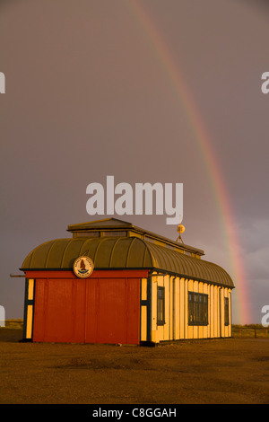 A rainbow arcs over the Alfred Corry Museum at Southwold Harbour in Suffolk - Stock Photo