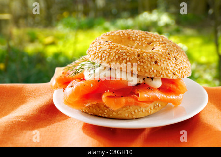 smoked salmon &  mayonnaise bagel. - Stock Photo