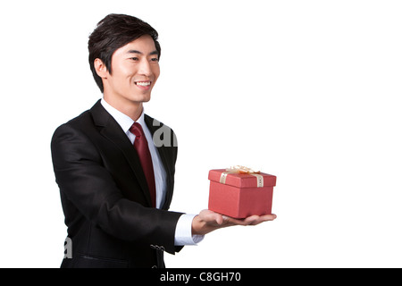 Businessman Holding a Gift - Stock Photo