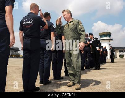 Lt. Gen. Herbert J. 'Hawk' Carlisle greets the Thunderbirds maintenance team prior to his flight with the team during - Stock Photo