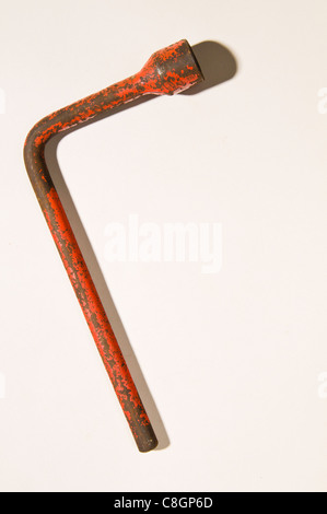Old rusty wheel Spanner / Wrench - Stock Photo