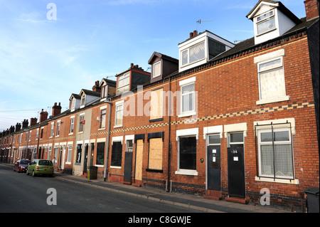 Terraced houses boarded up in Port Street Burslem Stoke on Trent Staffordshire England Uk - Stock Photo
