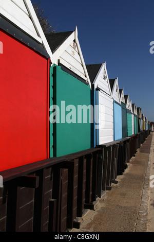colourful beachhuts on bournemouth beach - Stock Photo