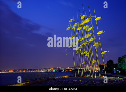 Greece, Thessaloniki. An artistic installation, called 'The Umbrellas' by George Zoggolopoulos, on the waterfront - Stock Photo