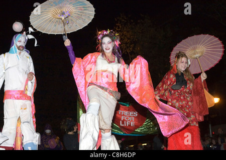 Attendees dressed in costume participate during  the annual Halloween Parade in Greenwich Village New York. - Stock Photo