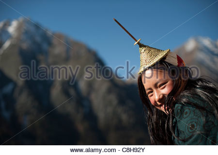 A Layap girl smiles for the camera in the remote village of Laya. - Stock Photo