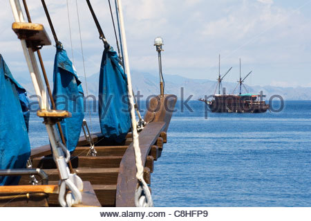 Traditional Indonesian two masted sailing ships, called Pinisi, at anchor. - Stock Photo
