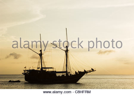 A traditional Indonesian two masted sailing ship, called a 'pinisi'. - Stock Photo