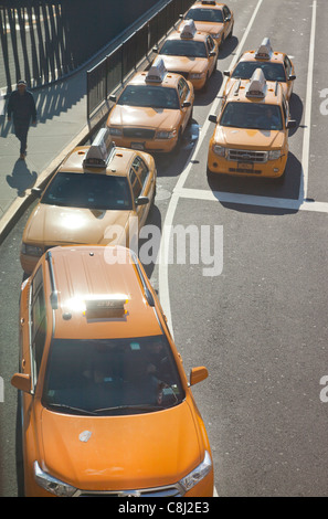 line of taxi cabs in New York City - Stock Photo