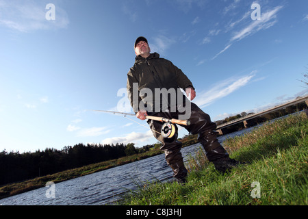 Fly fisherman fishing for salmon on the world famous River Dee in Aberdeenshire, Scotland, UK - Stock Photo