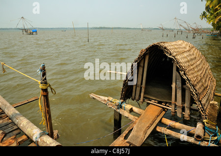 Chinese fishing nets on a tidal  lake near Fort Kochi ( Cochin ) showing the nets and basic shelter for the fishermen - Stock Photo