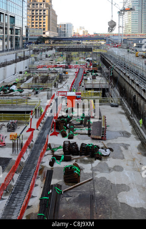 Work in progress Canary Wharf Crossrail train station site under construction in cofferdam in West India Docks Isle - Stock Photo
