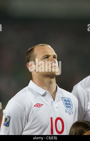 Wayne Rooney of England stands for team introductions before a 2010 World Cup Group C match against the United States. - Stock Photo