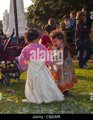 Nice, France, Young Children in Fancy Dress, Enjoying Annual Carnival Events on Street - Stock Photo