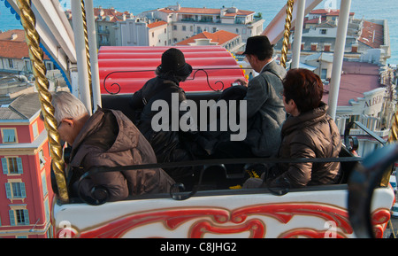 Nice, France, Chinese Tourists Riding on Ferris Wheel in Town Square, Annual Carnival Events on Street - Stock Photo