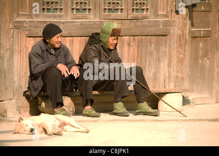 In morning sunshine.  Chinese countryside, village life, being old in China, socializing, Chinese minorities, ethnic - Stock Photo
