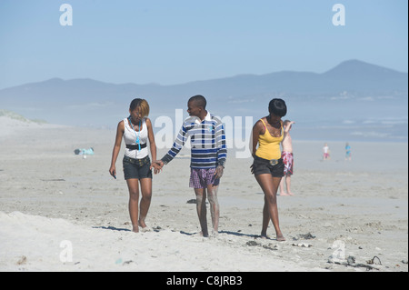 Teenager friends on Grotto Beach Western Cape South Africa - Stock Photo