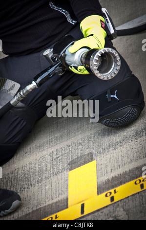 McLaren Formula One Mechanic and Wheel Gun - Stock Photo