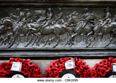 Sculpture of Cavalry and poppy tributes in Hyde Park - Stock Photo