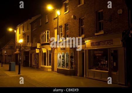 Shops in Henley Street at night, Stratford-upon-Avon, England, UK - Stock Photo