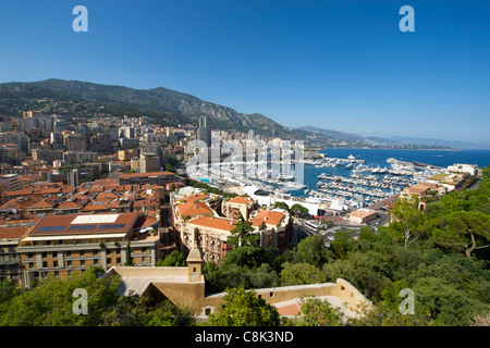 View of Port Hercule and the city and Principality of Monaco on the French Riviera along the Mediterranean coast. - Stock Photo