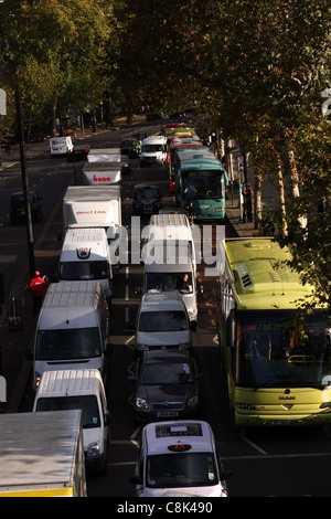 queue of traffic along the embankment of the River Thames, in London, during morning rush hour - Stock Photo