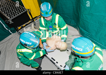 Paramedics demonstrate the decontamination procedure during the launch of Northern Ireland Ambulance Service (NIAS) - Stock Photo