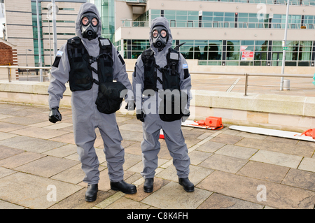Police officers wearing Quick Don Protective Suits for Chemical Biological Radiation and Nuclear (CBRN) protection - Stock Photo