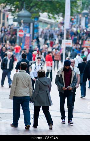 Saturday shoppers on New Street, Birmingham, UK - Stock Photo