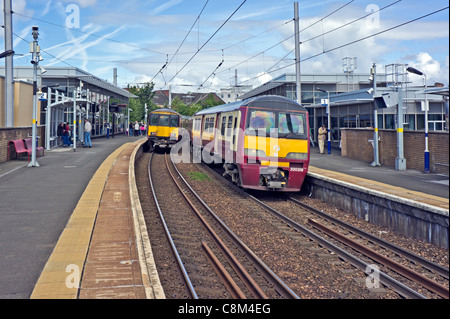 Scotrail EMU units Class 318 westbound (left) and 320 eastbound (right) passing at Partick Railway station in Glasgow - Stock Photo