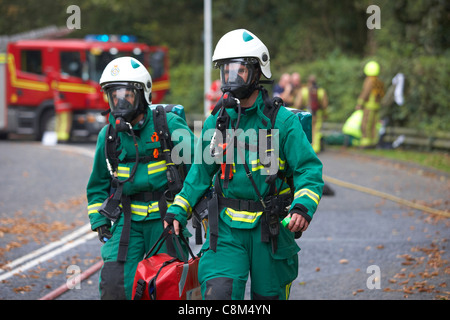 Paramedics wearing oxygen masks and fire crew attend a road traffic accident simulation in East Yorkshire, UK - Stock Photo