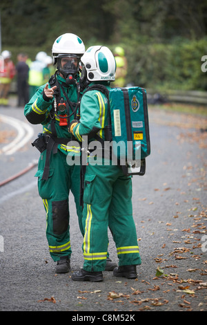 Paramedics wearing oxygen masks attend a road traffic accident simulation in East Yorkshire, UK - Stock Photo
