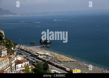 YELLOW PARASOLS ON BEACH VIETRI SUL MARE ITALY 18 September 2011 - Stock Photo