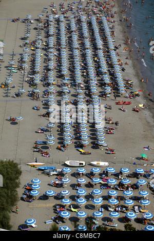 BLUE & YELLOW PARASOLS ON BEACH MARINA DI VIETRI ITALY 18 September 2011 - Stock Photo
