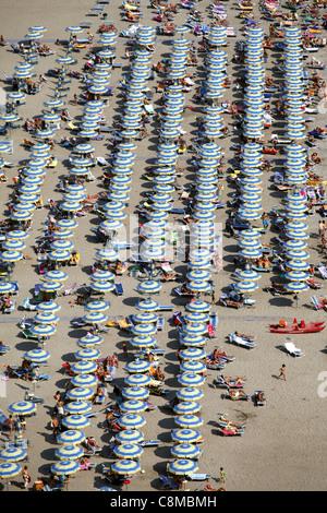 BLUE WHITE & YELLOW PARASOLS ON BEACH MARINA DI VIETRI ITALY 18 September 2011 - Stock Photo