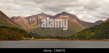 Bidean nam Bian and Glencoe village across Loch Leven - Stock Photo
