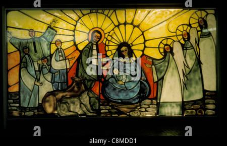 Christmas Nativity scene stain glass - Stock Photo