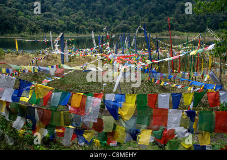 A place of pilgrimage for Hindus and Buddhists prayer flags at Khecheopalri Lake Sikkim India - Stock Photo