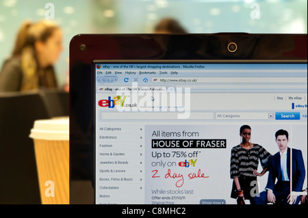 The eBay website shot in a coffee shop environment (Editorial use only: print, TV, e-book and editorial website). - Stock Photo