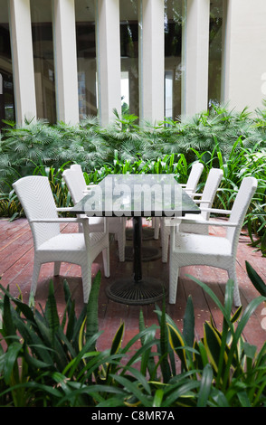 Dinning table and chairs in garden - Stock Photo