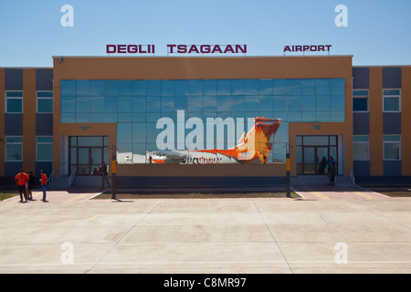 Deglii Tsagaan airport in Mongolia with plane reflected in glass terminal - Stock Photo