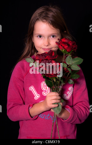 little girl with red roses - Stock Photo