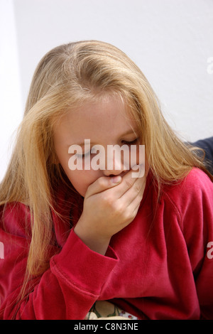 Young girl, 10 years old, sick in bed, having a flu. - Stock Photo