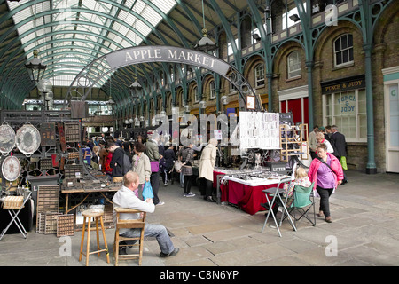 General view of Covent Garden Apple Market showing shoppers looking at antiques and bric- a brac - Stock Photo