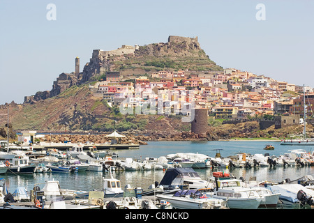 Italy, Sardinia, Castelsardo, view of medieval town and fortress on hilltop across the port - Stock Photo