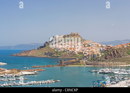 Italy, Sardinia, Castelsardo, view towards town and fortress on hilltop across the port - Stock Photo