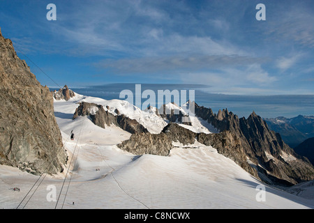 Italy, Piemonte, View from Italian side (Punta Helbronner) to the French (Aiguille du Midi), cable car linking the - Stock Photo