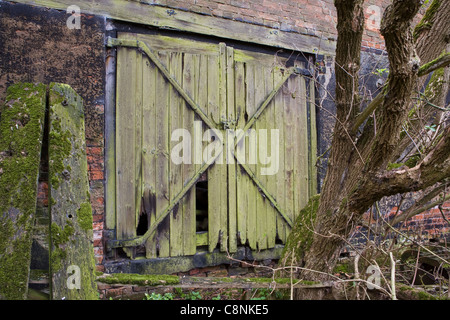 Barn door in a block of obsolete old fenland farm buildings. - Stock Photo
